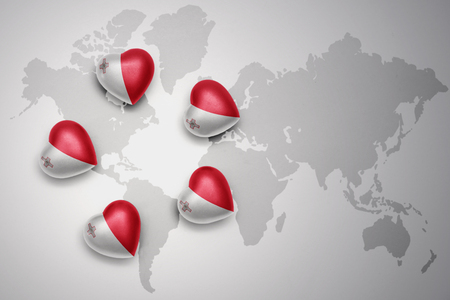 five hearts with national flag of malta on a world map background..concept.3D illustration Stock Photo