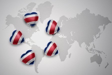 five hearts with national flag of costa rica on a world map background..concept.3D illustration Stock Photo