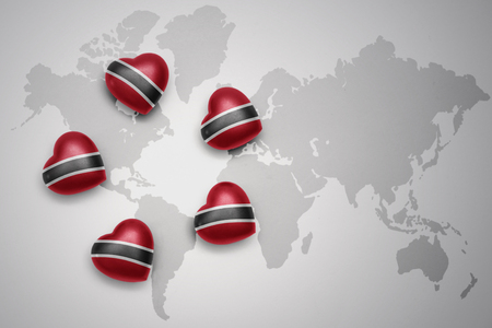 five hearts with national flag of trinidad and tobago on a world map background..concept.3D illustration