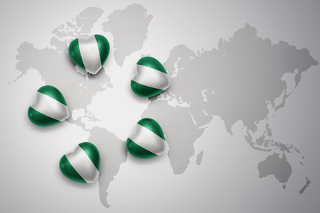 five hearts with national flag of nigeria on a world map background..concept.3D illustration