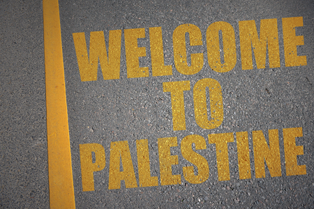 asphalt road with text welcome to palestine near yellow line. concept