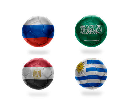 soccer team group A . realistic football balls with national flags of russia, saudi arabia, egypt, uruguay