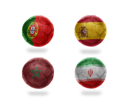 soccer team group B . realistic football balls with national flags of portugal, spain, morocco, iran