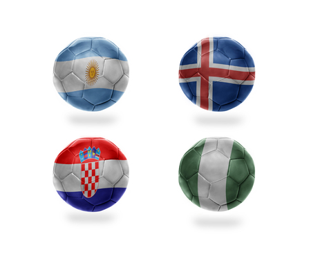 soccer team group D . realistic football balls with national flags of argentina, iceland, croatia, nigeria Stock Photo