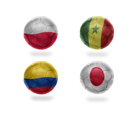 soccer team group H . realistic football balls with national flags of poland, senegal, colombia, japan