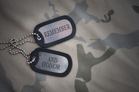 army blank, dog tag with text remember and honor on the khaki texture background. military concept Stock Photo