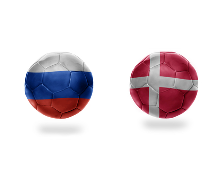 football balls with national flags of denmark and russia.isolated on the white background. 3D illustration