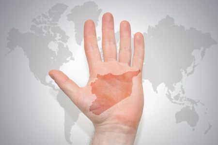 hand with map of syria on the gray world map background. concept Stock Photo