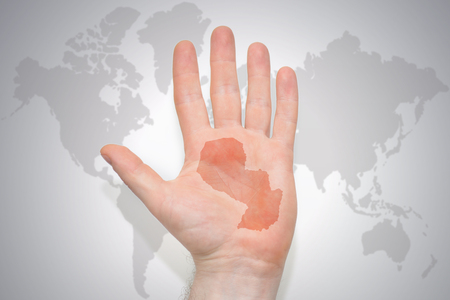 hand with map of paraguay on the gray world map background. concept