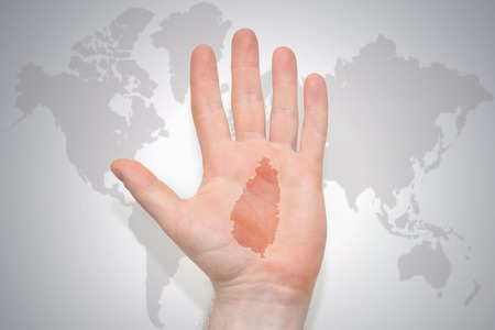 hand with map of saint lucia on the gray world map background. concept