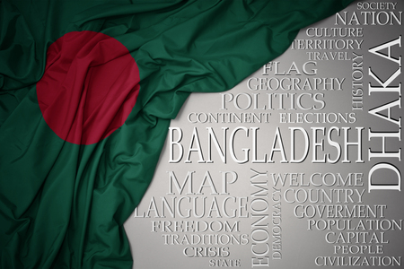 waving colorful national flag of bangladesh on a gray background with important words about country . concept Stock Photo