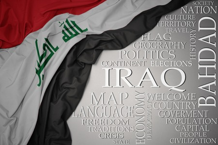 waving colorful national flag of iraq on a gray background with important words about country . concept