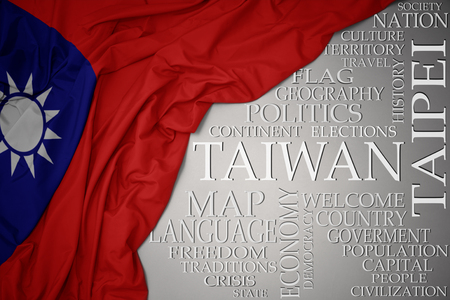 waving colorful national flag of taiwan on a gray background with important words about country . concept