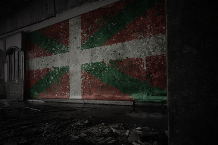 painted flag of basque country on the dirty old wall in an abandoned ruined house. concept Stock Photo - 124587613