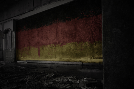 painted flag of germany on the dirty old wall in an abandoned ruined house. concept Stock fotó