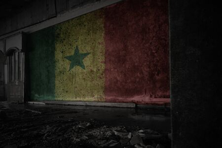 painted flag of senegal on the dirty old wall in an abandoned ruined house. concept Imagens