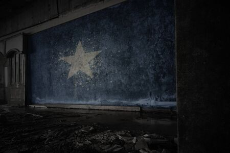 painted flag of somalia on the dirty old wall in an abandoned ruined house. concept Imagens