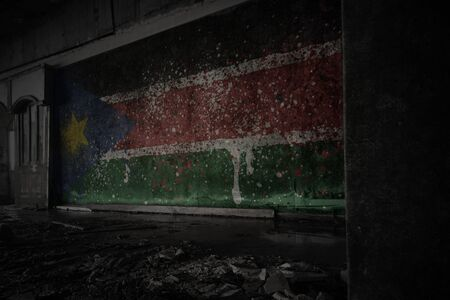 painted flag of south sudan on the dirty old wall in an abandoned ruined house. concept Imagens