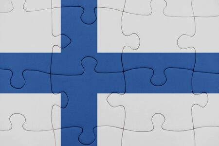 puzzle with the national flag of finland. concept