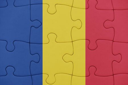 puzzle with the national flag of romania. concept Stock Photo