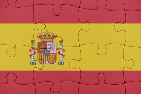 puzzle with the national flag of spain. concept