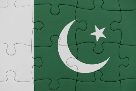 puzzle with the national flag of pakistan. concept Stock Photo