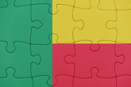 puzzle with the national flag of benin. concept
