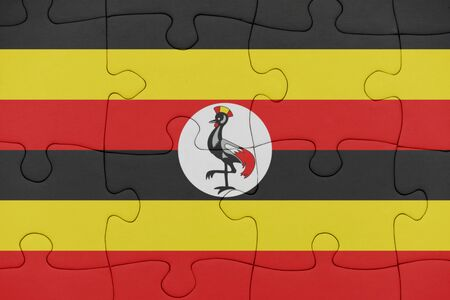 puzzle with the national flag of uganda. concept