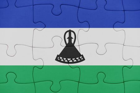 puzzle with the national flag of lesotho. concept