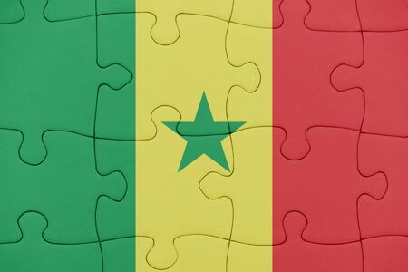 puzzle with the national flag of senegal. concept Stock Photo