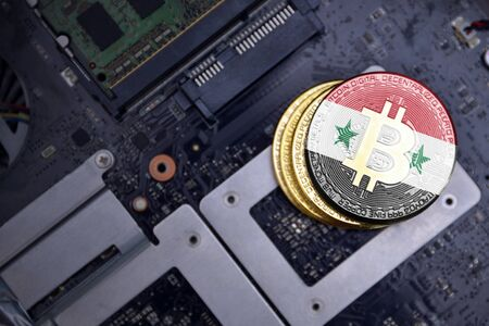 golden shining bitcoins with flag of syria on a computer electronic circuit board. bitcoin mining concept.