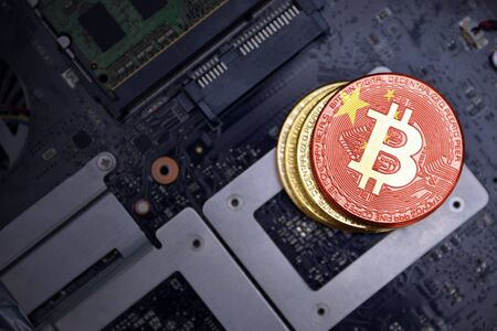 golden shining bitcoins with flag of china on a computer electronic circuit board. bitcoin mining concept.