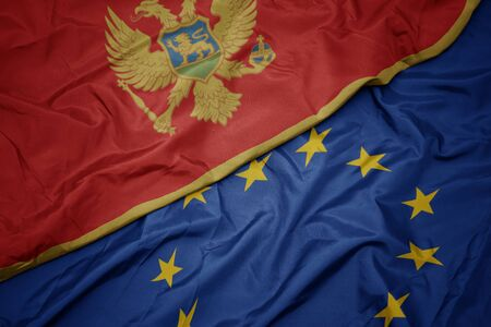 waving colorful flag of european union and national flag of montenegro. macro