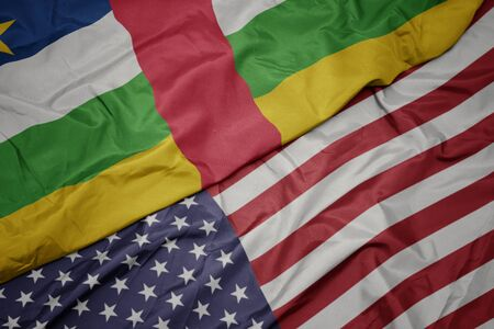 waving colorful flag of united states of america and national flag of central african republic. macro