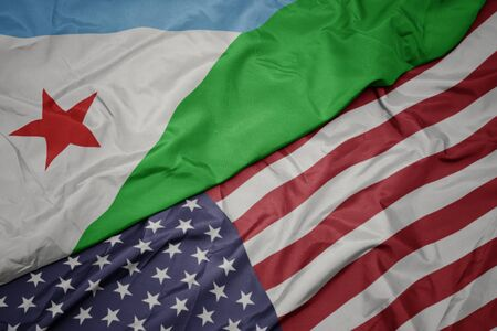 waving colorful flag of united states of america and national flag of djibouti. macro