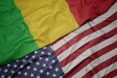 waving colorful flag of united states of america and national flag of mali. macro