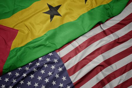 waving colorful flag of united states of america and national flag of sao tome and principe. macro
