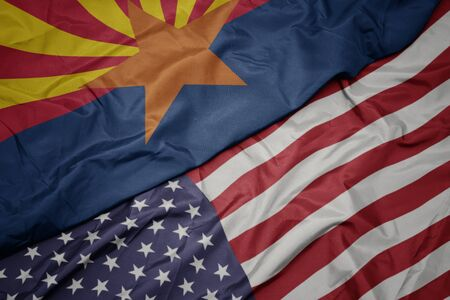 waving colorful flag of united states of america and flag of arizona state. macro