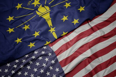 waving colorful flag of united states of america and flag of indiana state. macro