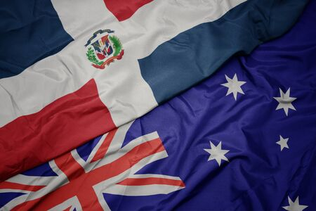 waving colorful flag of australia and national flag of dominican republic. macro