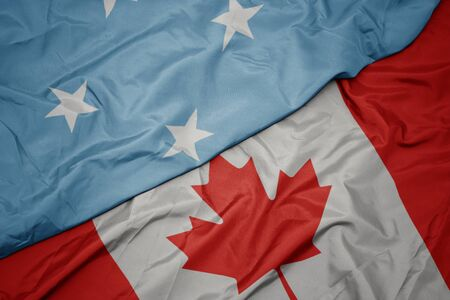 waving colorful flag of canada and national flag of Federated States of Micronesia. macro