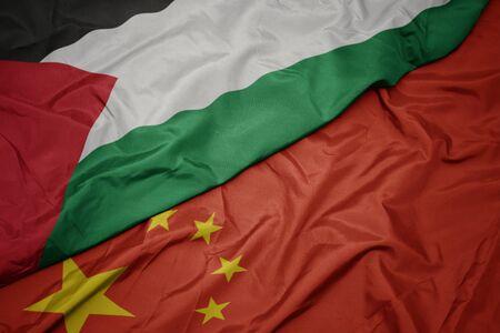 waving colorful flag of china and national flag of palestine. macro Imagens