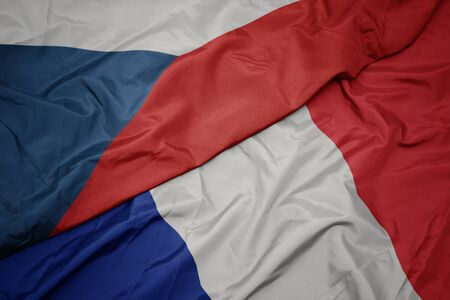 waving colorful flag of france and national flag of czech republic. macro Stockfoto