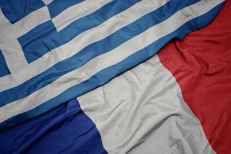 waving colorful flag of france and national flag of greece. macro Stockfoto