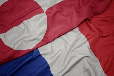 waving colorful flag of france and national flag of greenland. macro Stockfoto