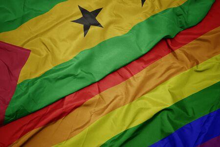 waving colorful rainbow flag and national flag of sao tome and principe. macro Stock Photo