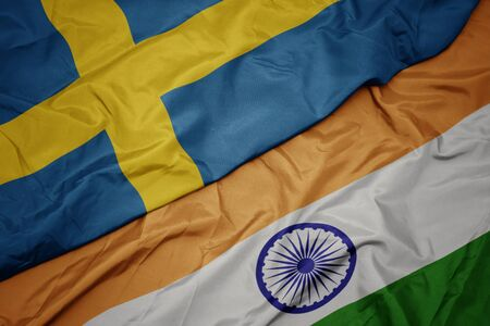 waving colorful flag of india and national flag of sweden. macro Stockfoto