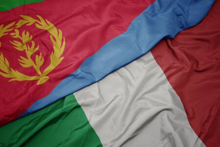 waving colorful flag of italy and national flag of eritrea. macro