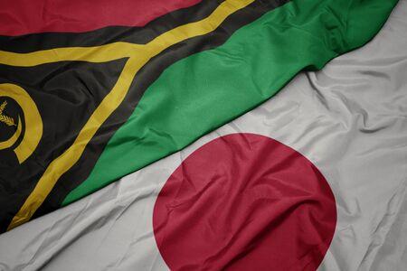 waving colorful flag of japan and national flag of Vanuatu. macro