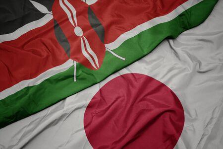 waving colorful flag of japan and national flag of kenya. macro 写真素材